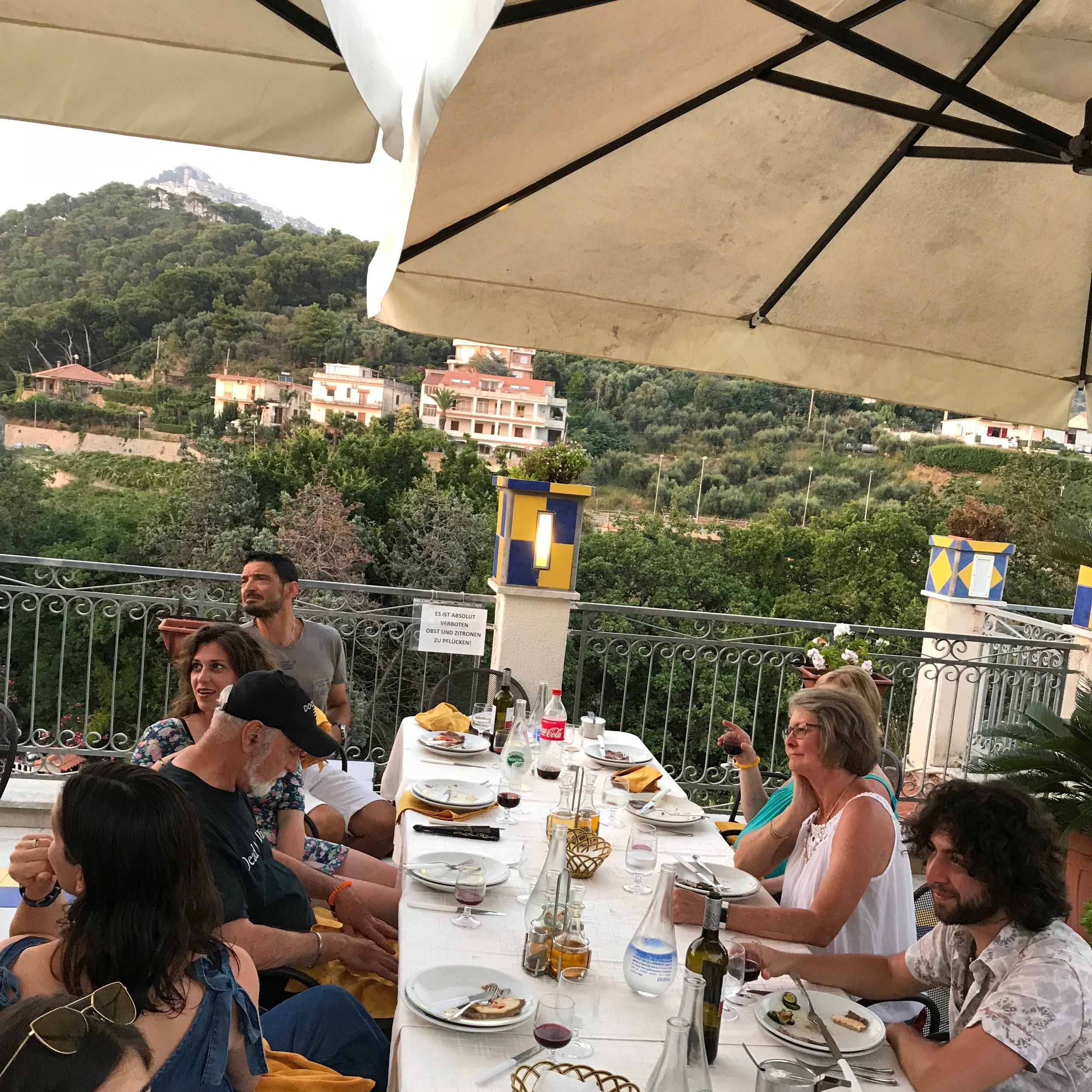 Alfresco dining at the Fondazione Passarelli overlooking the stunning Italian landscape.