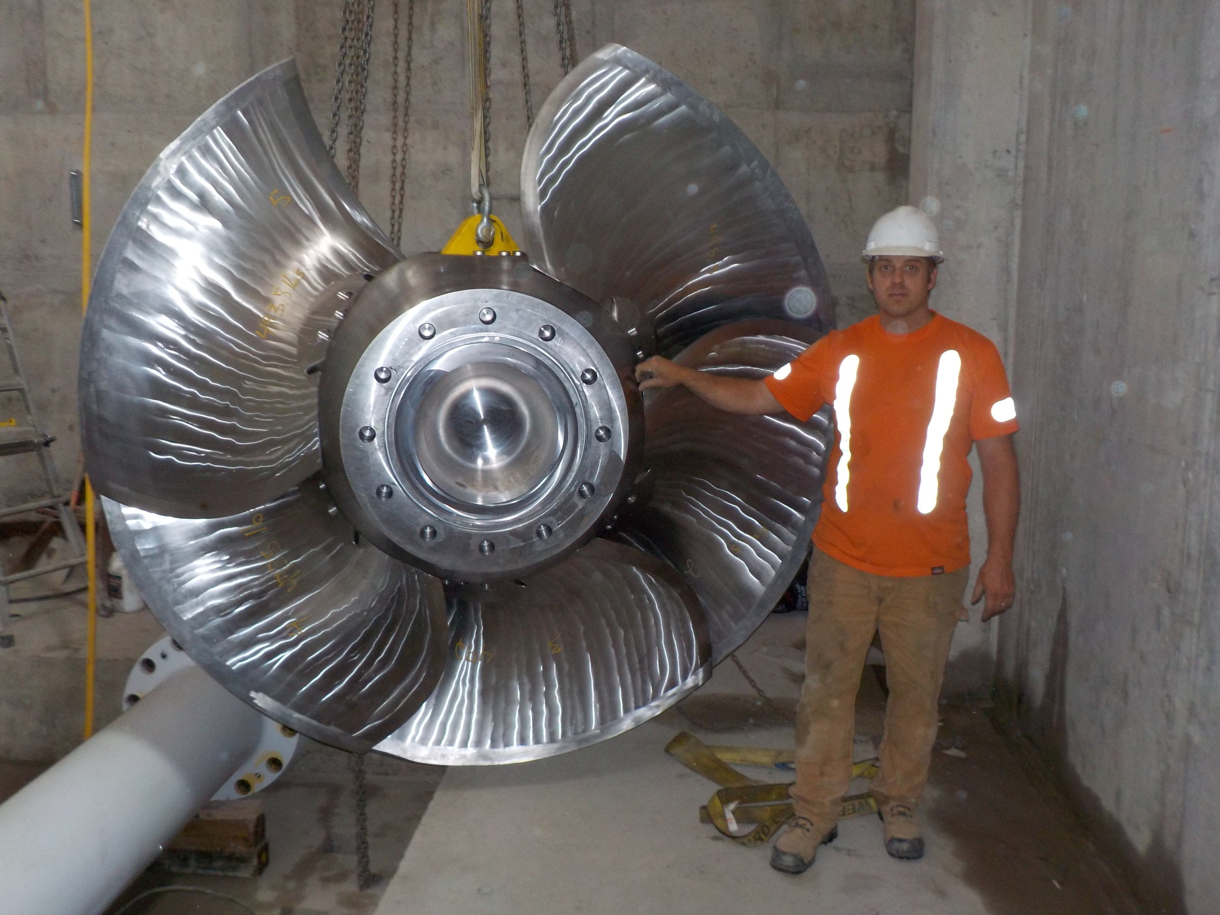 - The six-blade Kaplan turbine runner prior to install.