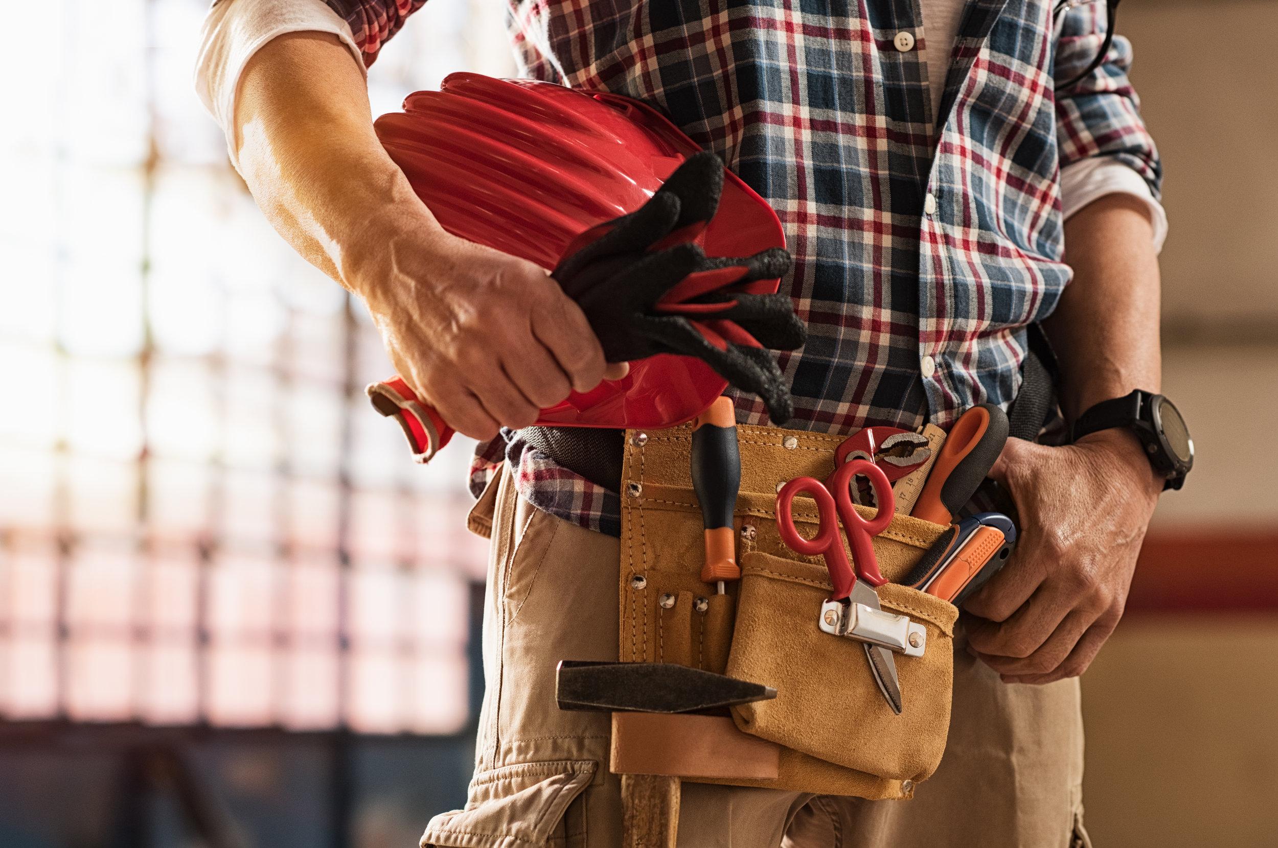 bigstock-Closeup-of-bricklayer-hands-ho-230406682.jpg