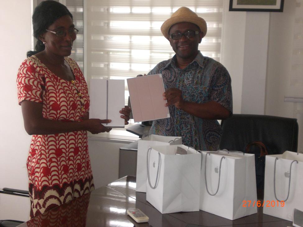 Presenting the iPad to Mrs. Juliana Ackah