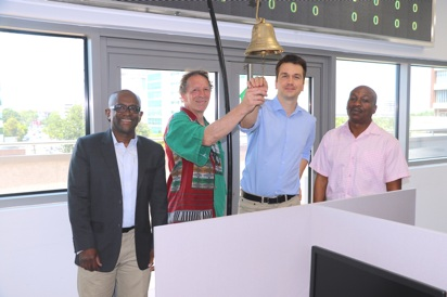 L-R: Professor Chris Udry, our friend/supporter, and Dr. Kadri Alfah ringing the GCX trading bell