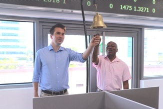 L-R: Our friend/supporter and Dr. Kadri Alfah ringing the GCX trading bell