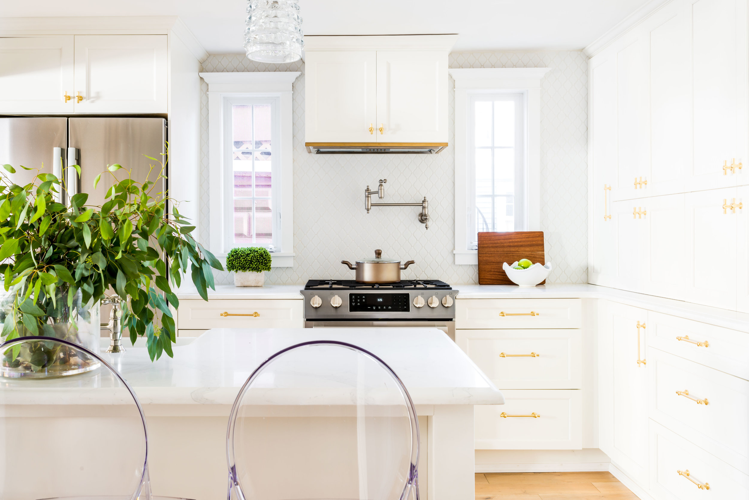 Hardware: Cowan from  Rejuvenation Hardware ; Long Ribbon Pendant Light from  Jamie Young Co .; fixtures:  Kingston Brass ; Flooring: BuildDirect. Backsplash:  Merola Tile from Home Depot , in Arabesque Glossy. Design:  Molly Pidgeon, Principal & Interior Designer, House of Dietrich  // Photo:  Jessica Delaney