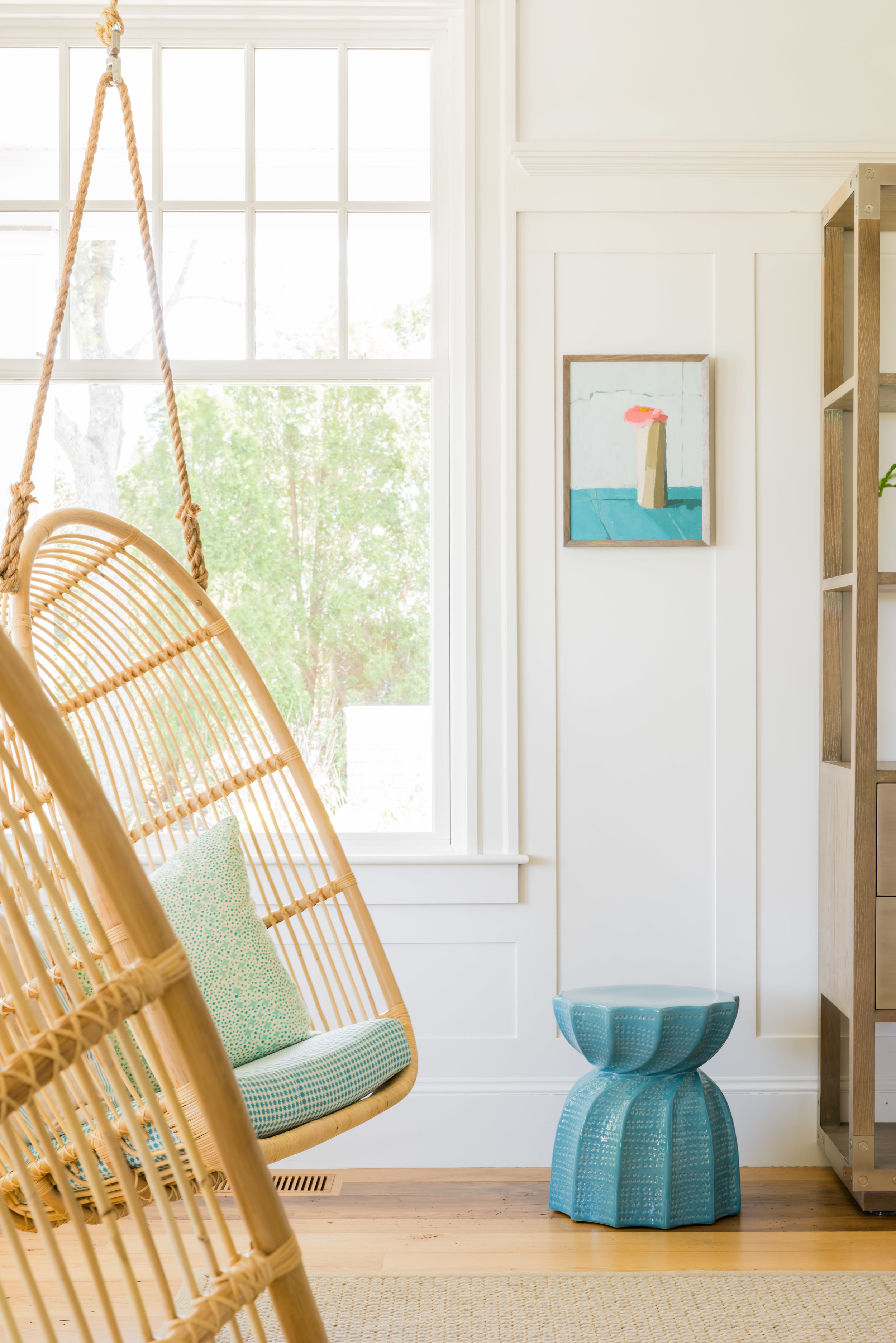 Bea Stool in Soft Blue by  Made Goods ; Renoir Swing Chair by  Sika Design . Design:  Justine Sterling Design  // Photo:  Jessica Delaney