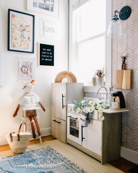Max's Playroom:  Soho Kitchen Set, Wayfair ,  Market Basket, Wayfair ,  Corynne Carpet, Lulu and Georgia ,  High Chair, Pottery Barn   mStarr Design  // Photo:  Jessica Delaney