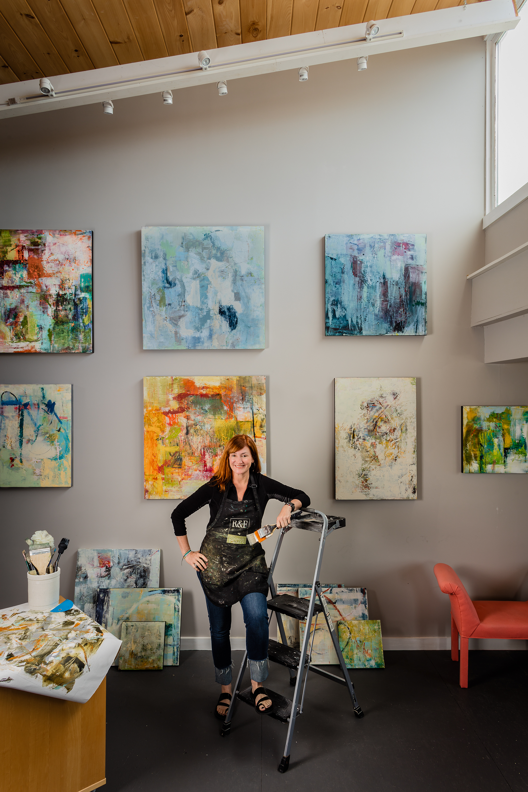 Artist Sallie Strand in her Rocky Neck gallery.  Photographed by Michael J. Lee