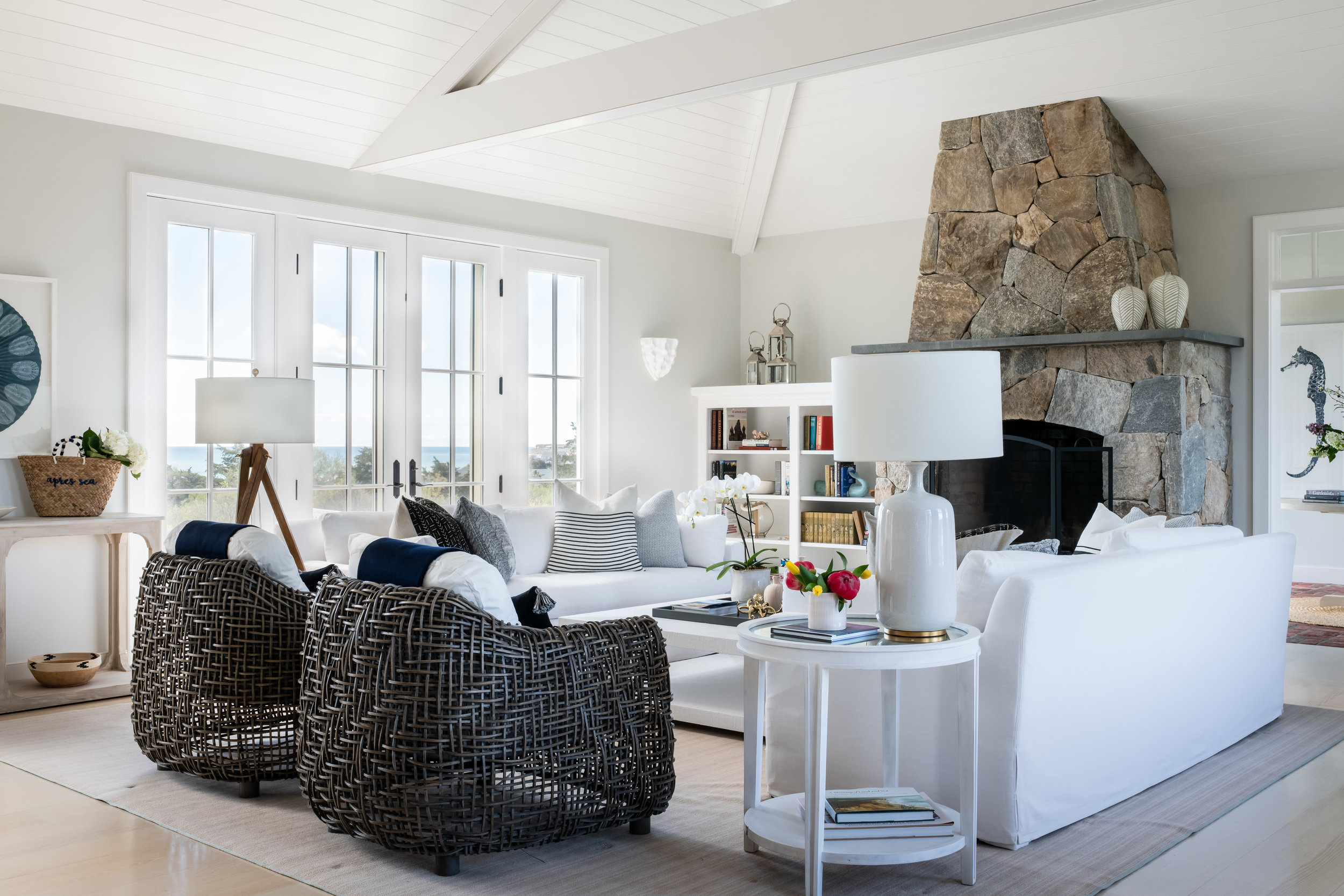 Living room: chairs,  Palecek ; sofa, throws and pillows,  Restoration Hardware ; floor and table lamps,  Visual Comfort ; coffee table,  Serena and Lilly . Design:  James Studio Interiors  // Photo:  Jessica Delaney .