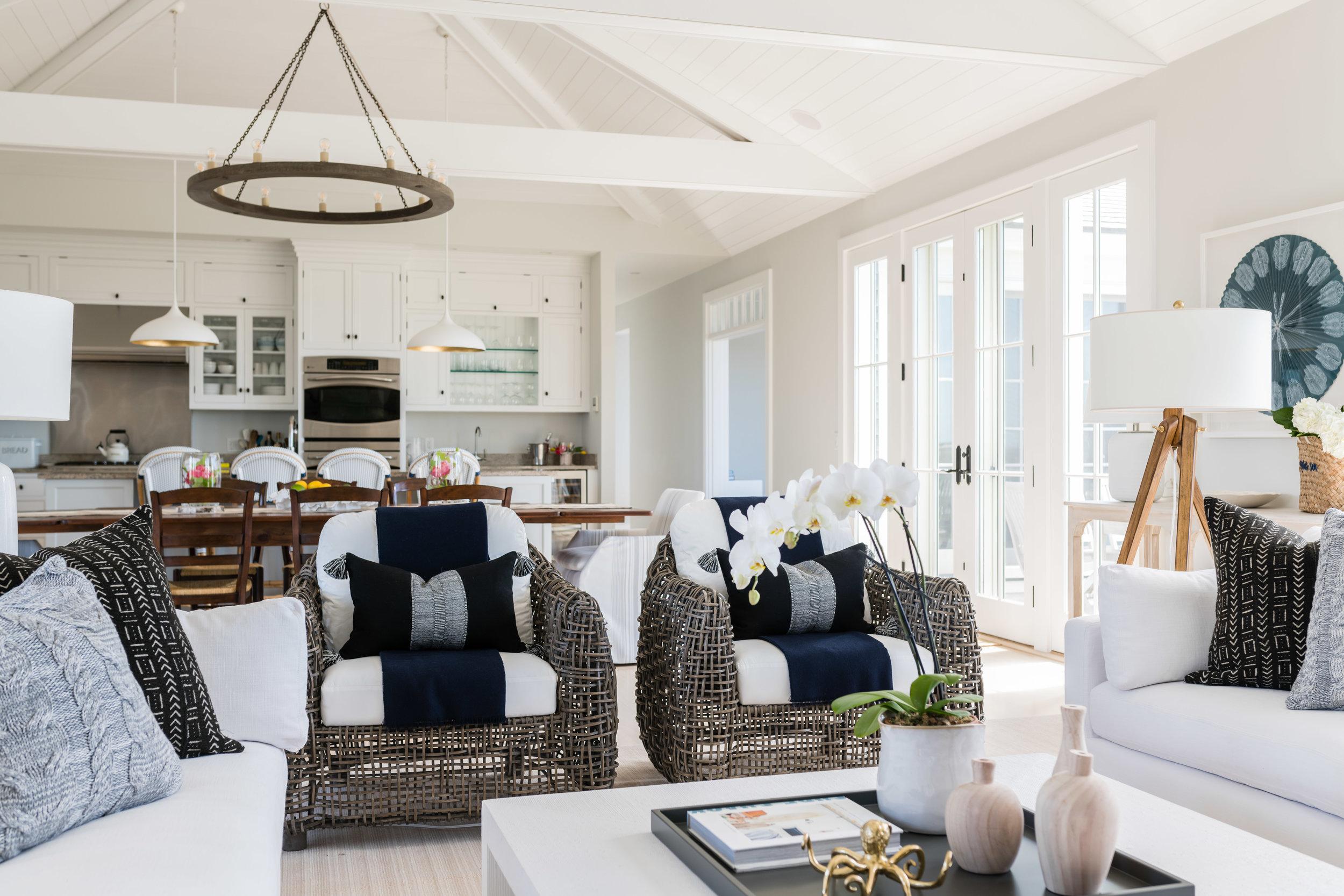 Living room, view to kitchen: chandelier,  Arteriors ; foreground accessories,  Doublemint Home . Design:  James Studio Interiors  // Photo:  Jessica Delaney .