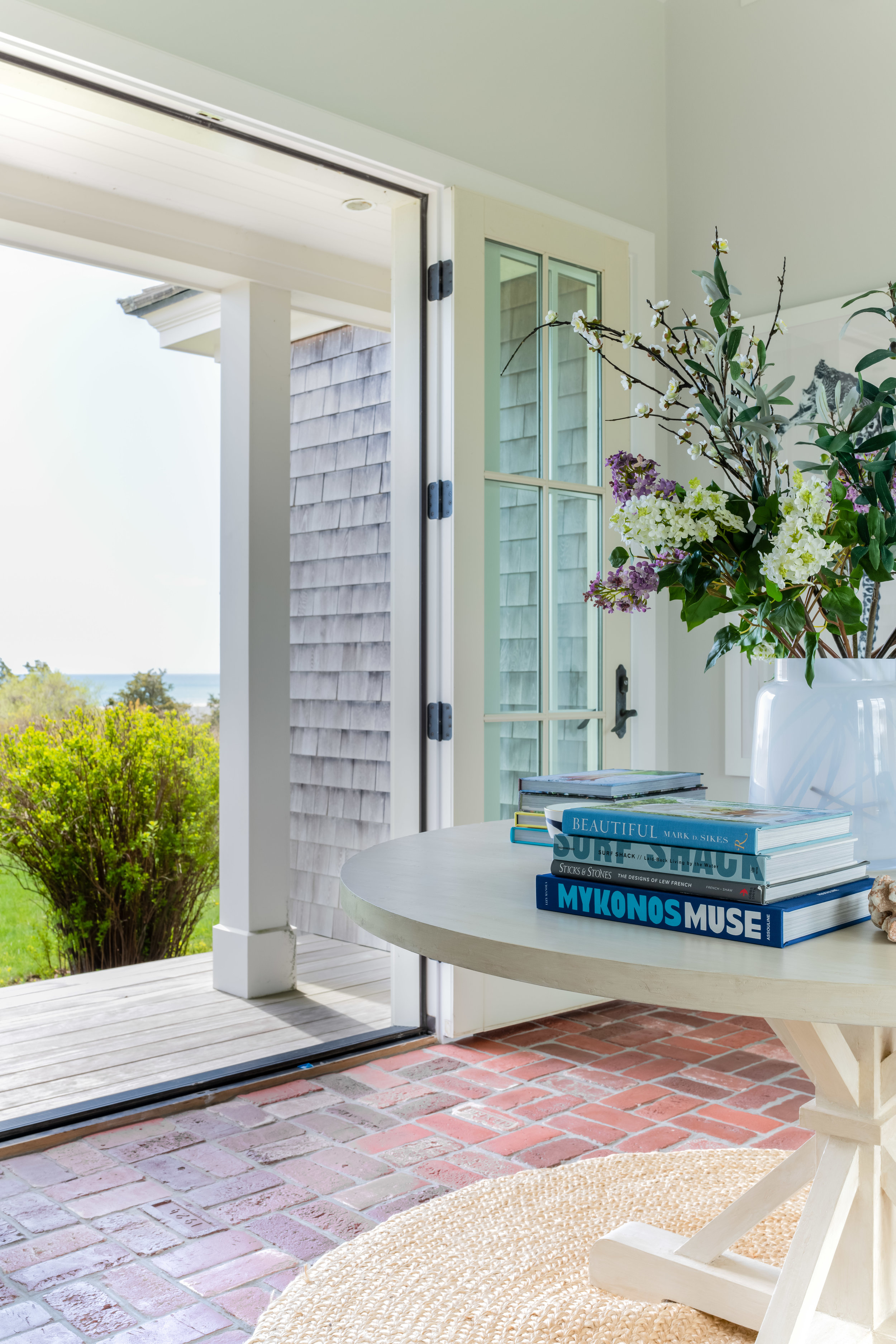 View from pass-through. Custom table,  Tritter Feefer.  Design:  James Studio Interiors  // Photo:  Jessica Delaney .