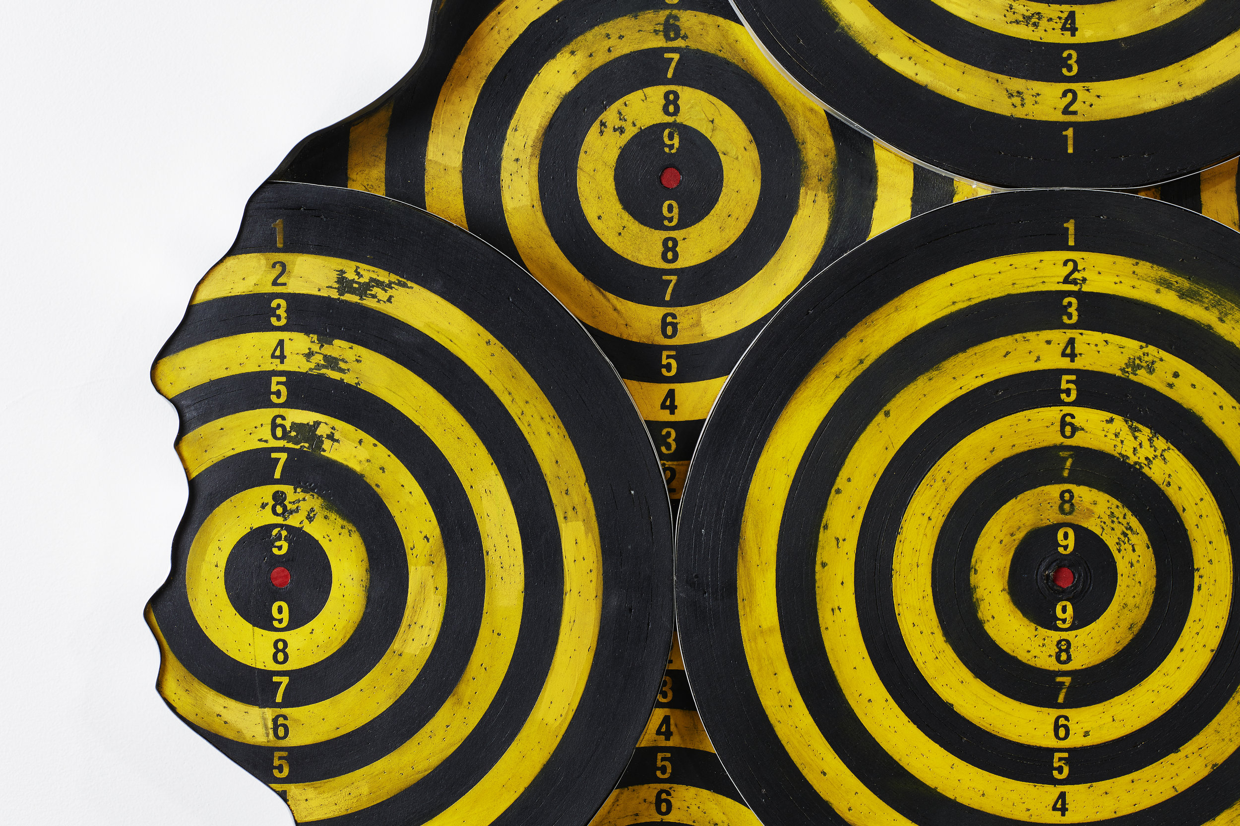 - The composition was made from authentic dartboards, water-jetted and finished with steel edging.