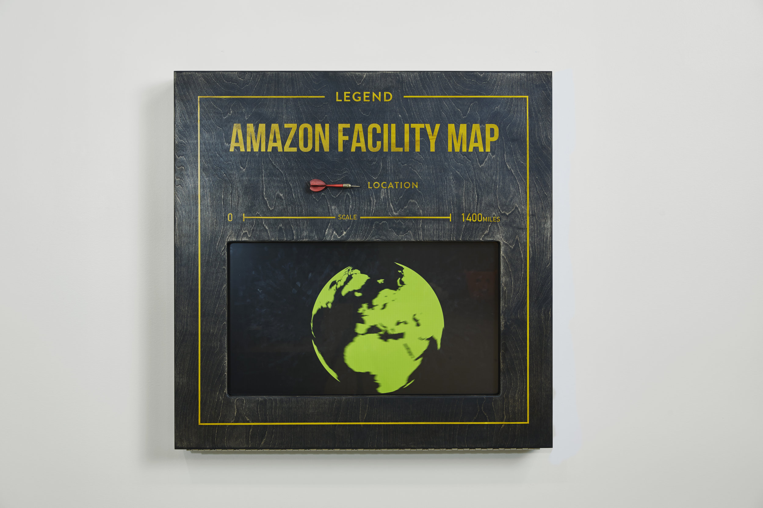 - Strategically placed red darts signified Amazon's fulfillment centers around the globe. An animated feature along the wall showcased those locations in depth.