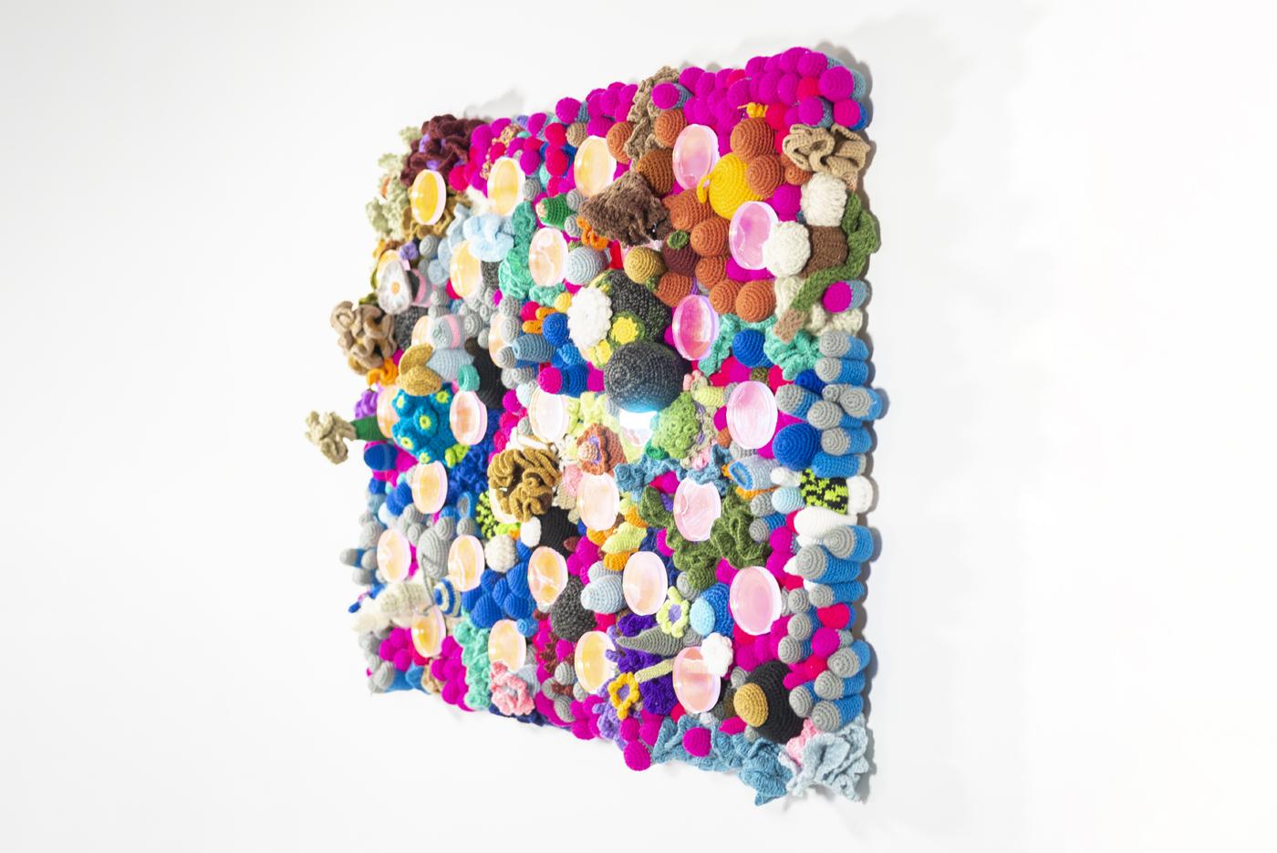 Acrylic, dichroic film, crochet on wood, untamed wonder.