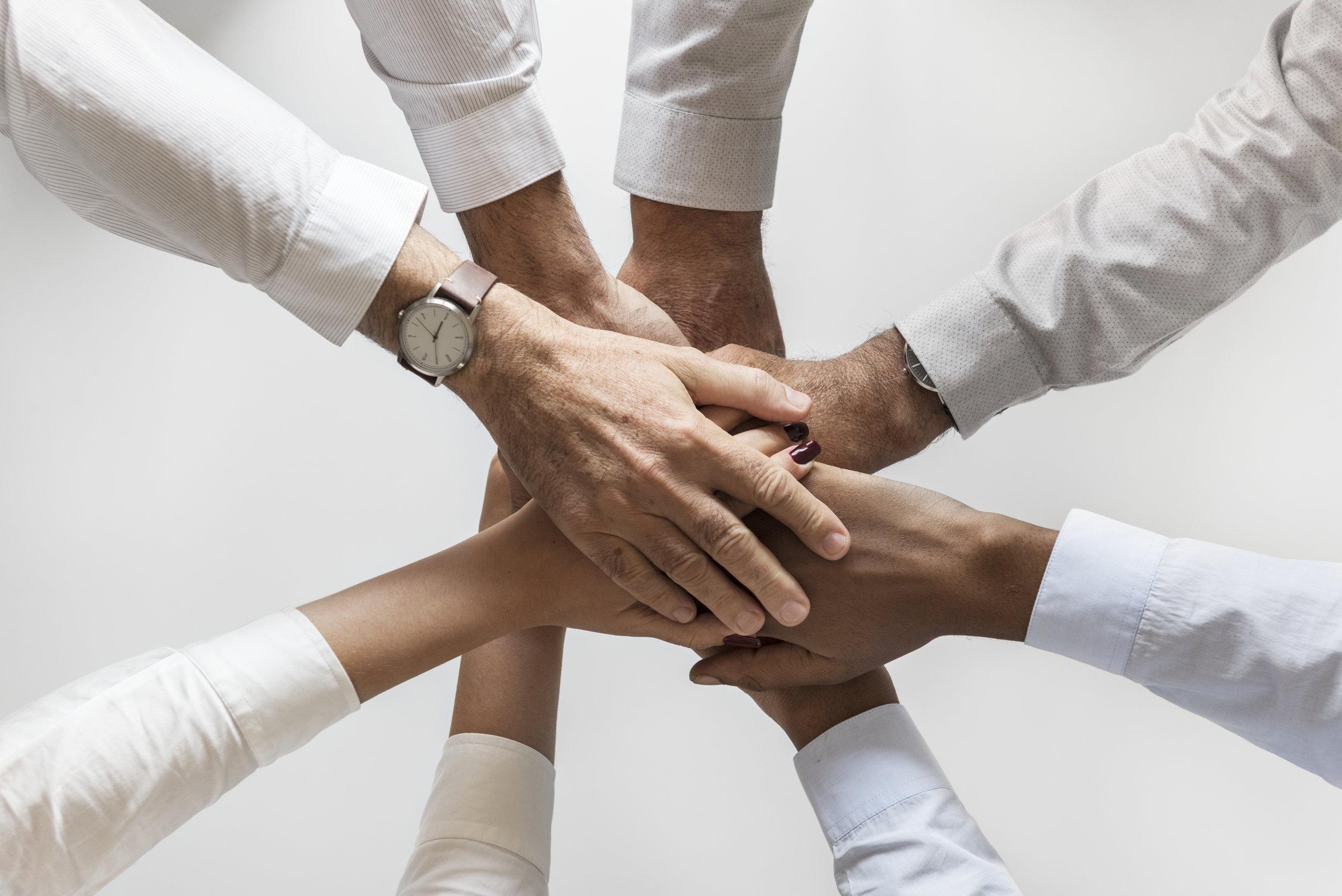 Business hands joined together teamwork