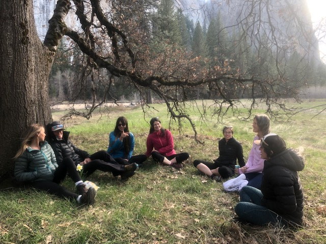 A sweet circle of ladies gather under the oak in El Capitan Meadow.  Photo credit: Brian Kaisaurer