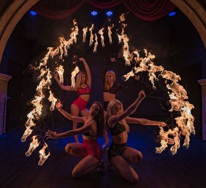 fire girls dancing twirl nashville beyond wings circus.jpg