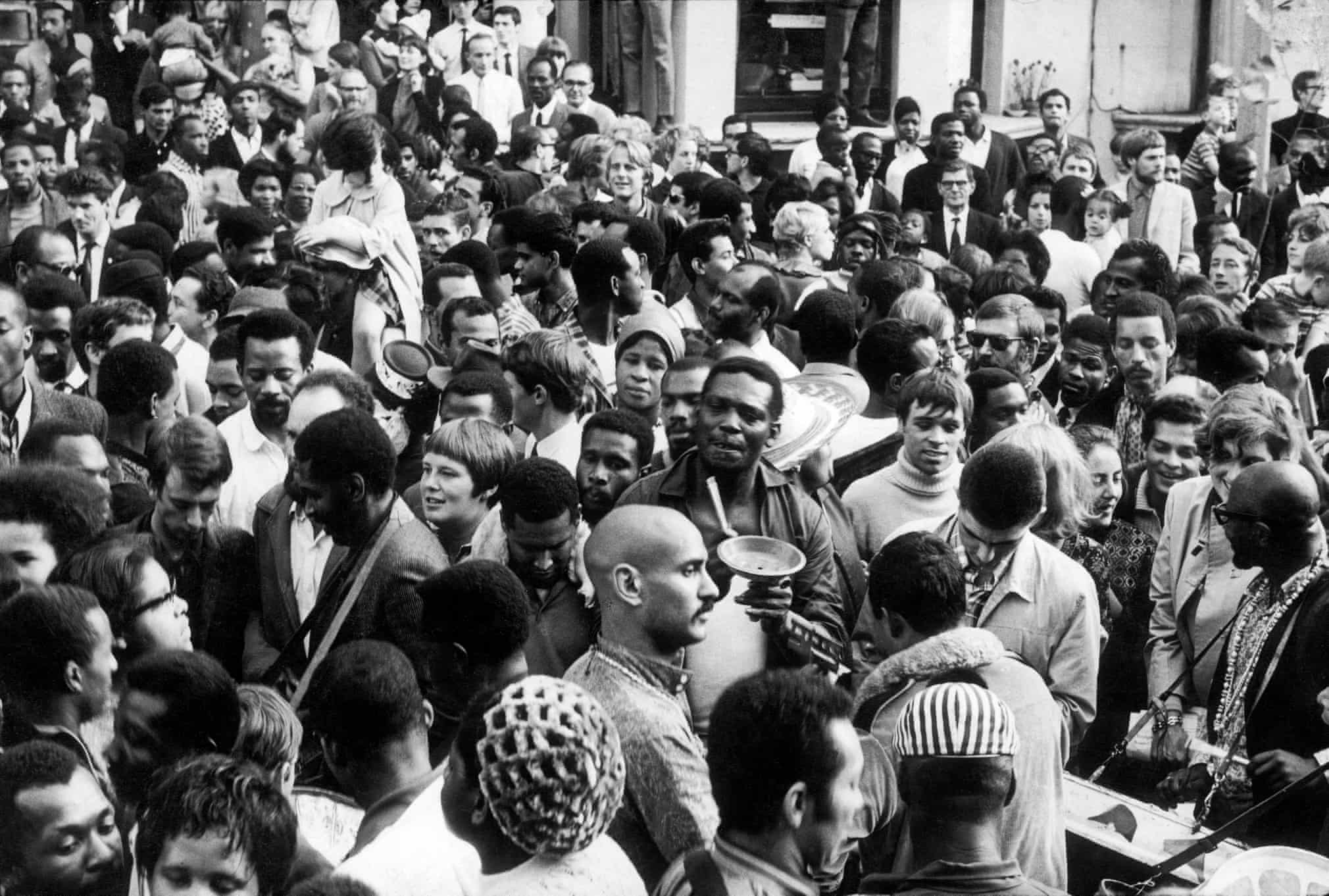 1968 . Crowds fill the streets at the Notting Hill carnival during the August bank holiday  Photograph: Charlie Phillips/Getty Images