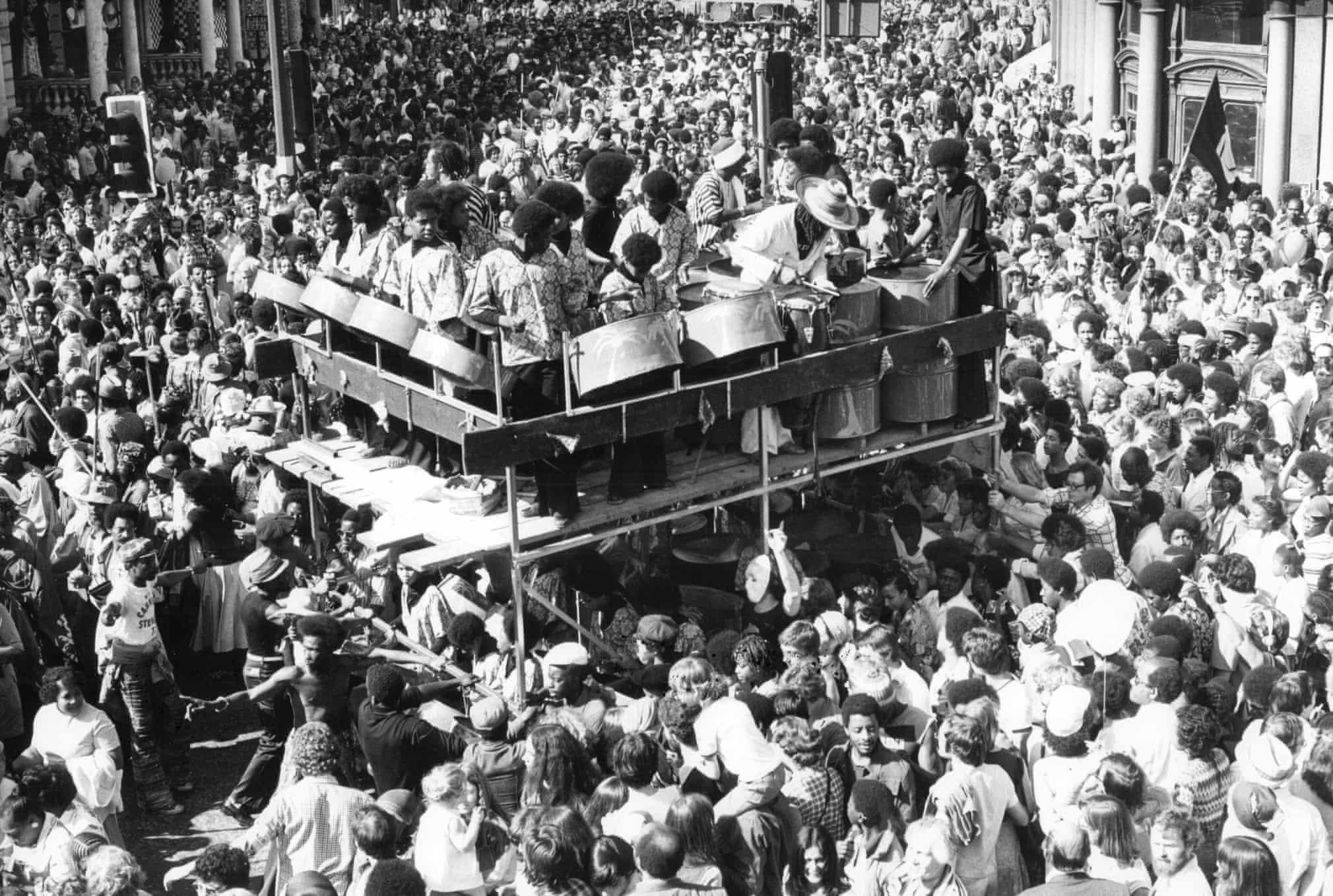 1977 . A vast crowd follow a steel band  Photograph: ANL/Rex/Shutterstock