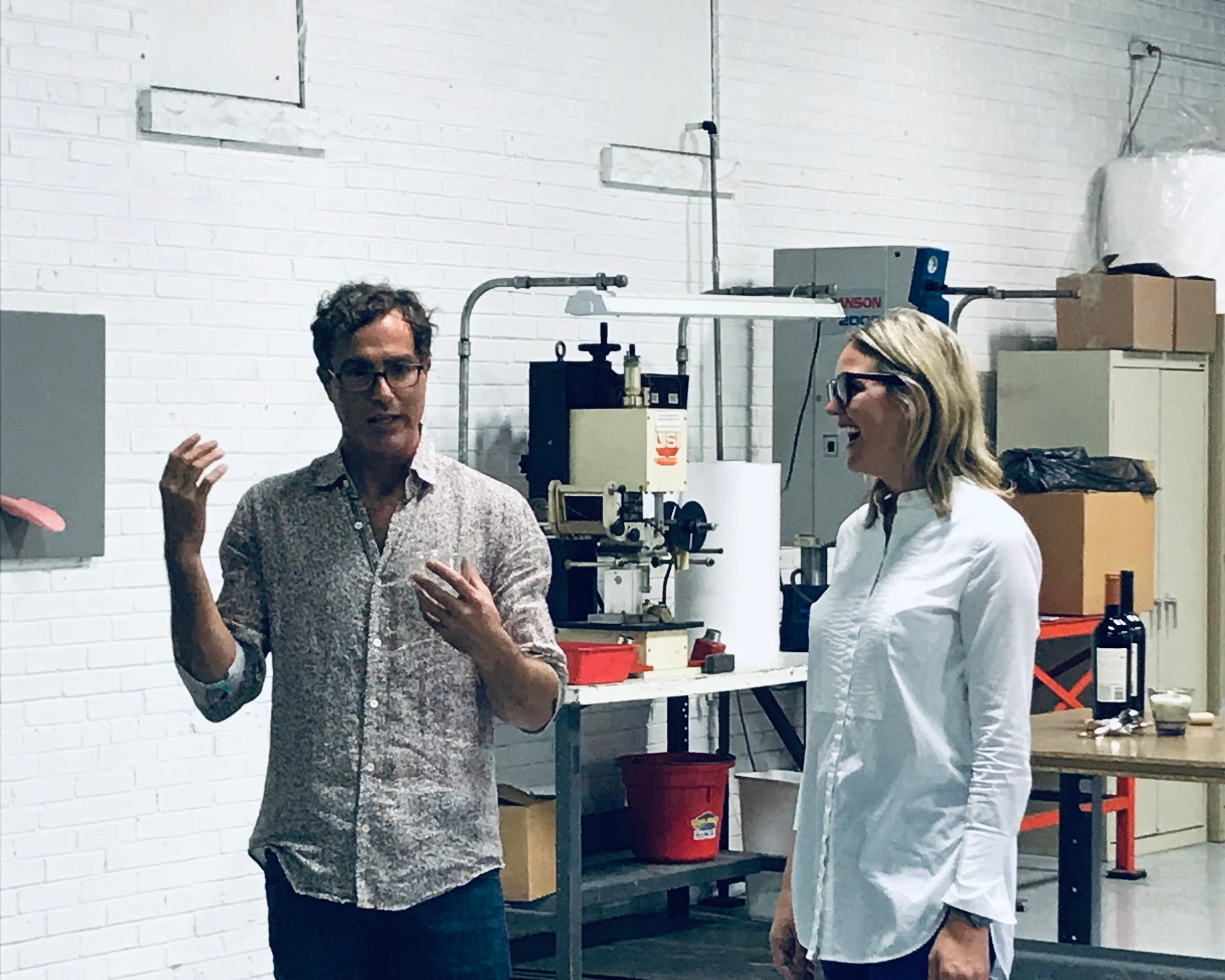 "LA-based artist, Eric Huebsch and Patricia Miller discussing the process of creation and use of material during the ""DE-commoditized"" art opening at M4."