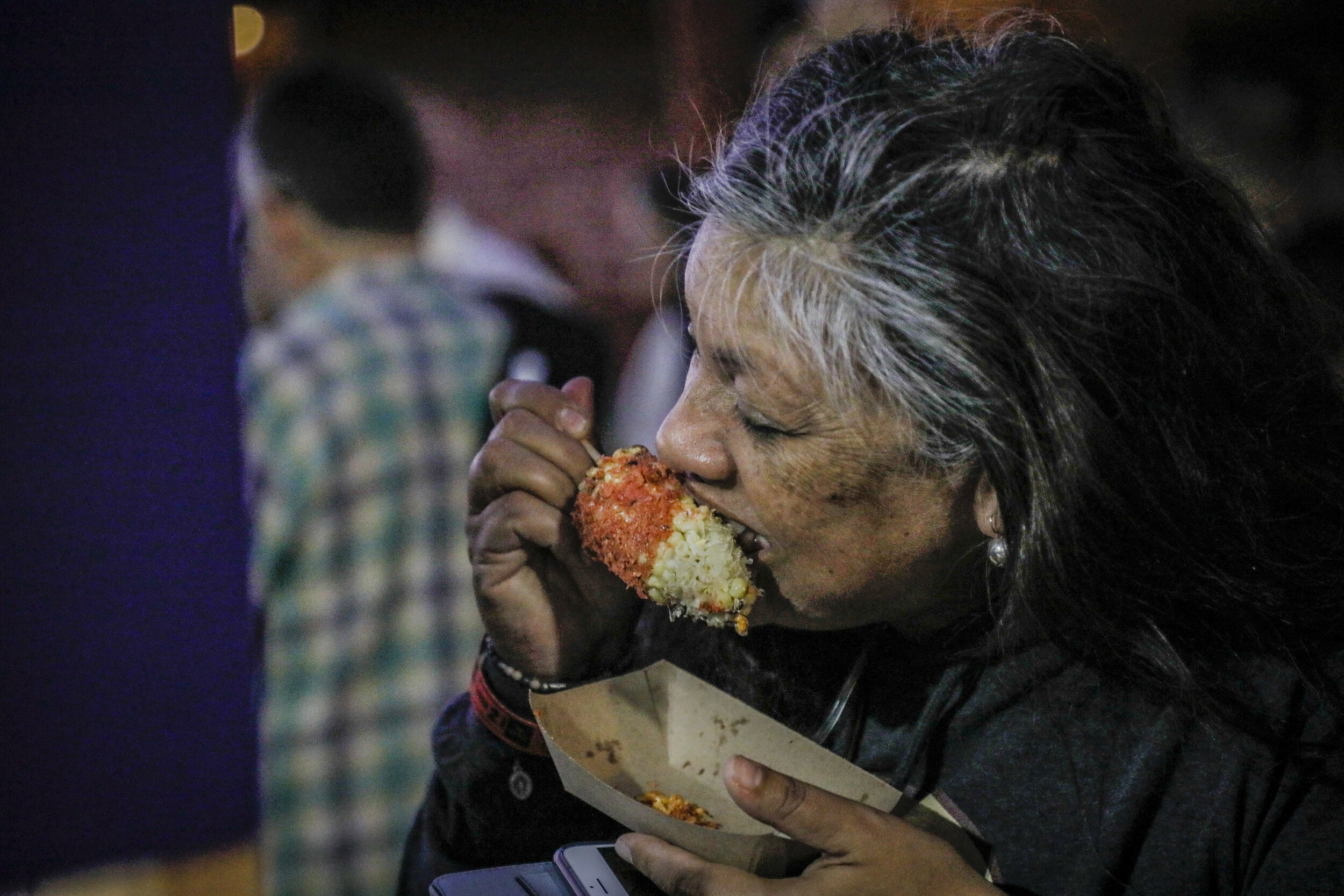 woman eating elotes.jpg