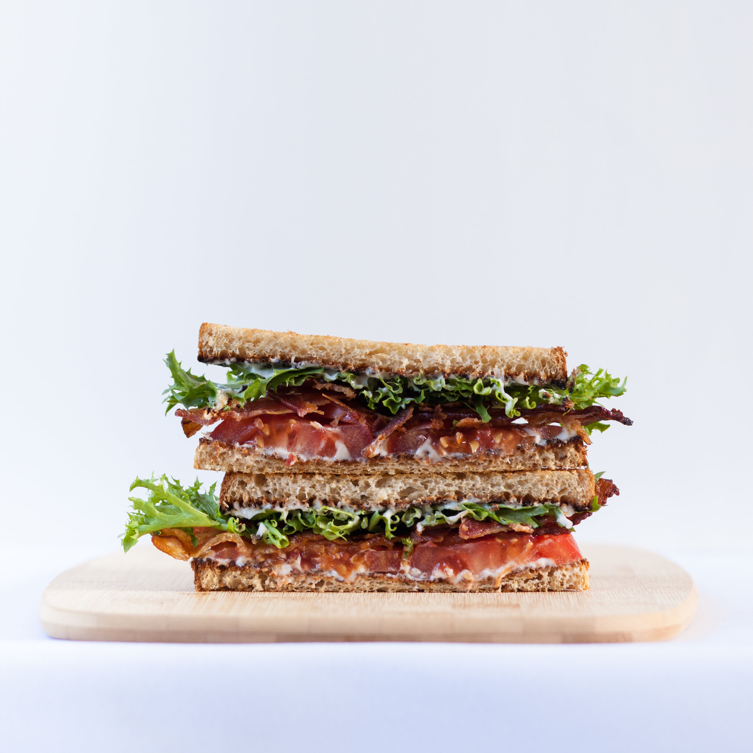 Stacked sandwich with bacon, lettuce, and tomato