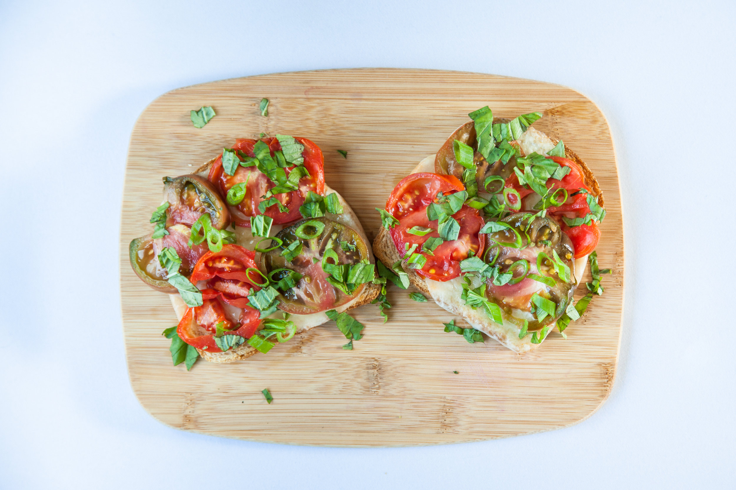 Toast with tomato, provolone, and basil