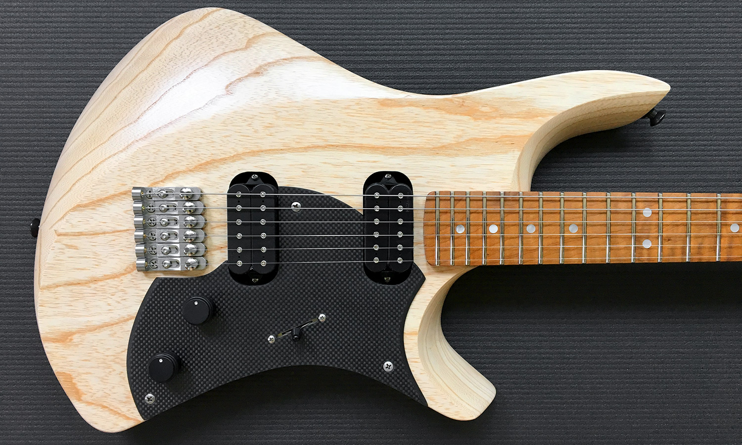 PHOTO: Goshawk™ natural Swamp Ash and roasted Flame Maple with mother of pearl inlays and bone nut.