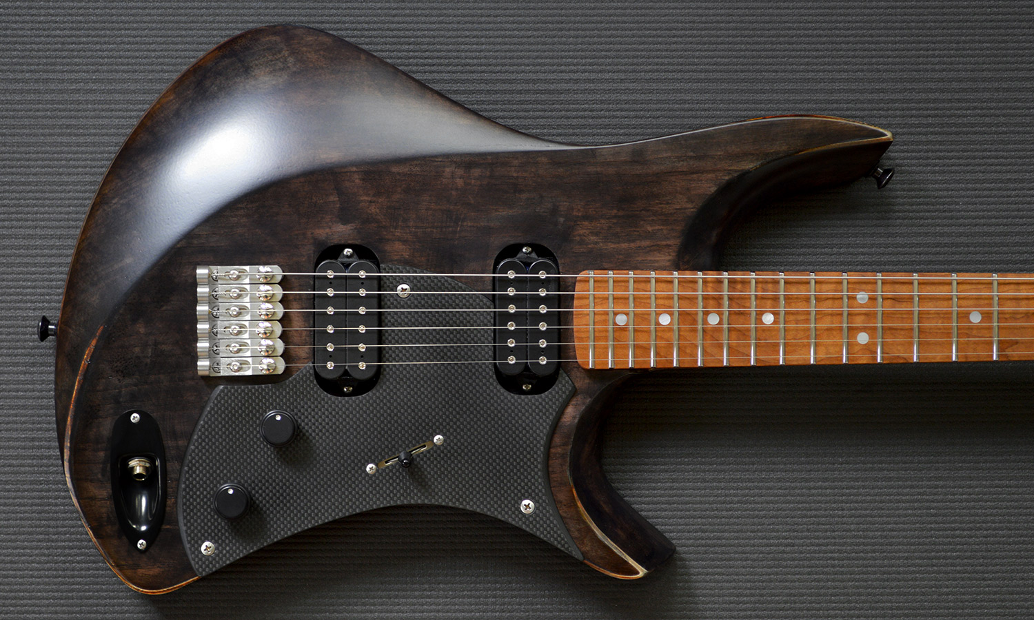 PHOTO: Goshawk™ Swamp Ash and roasted Flame Maple with mother of pearl inlays and bone nut. Iceland-inspired finish.