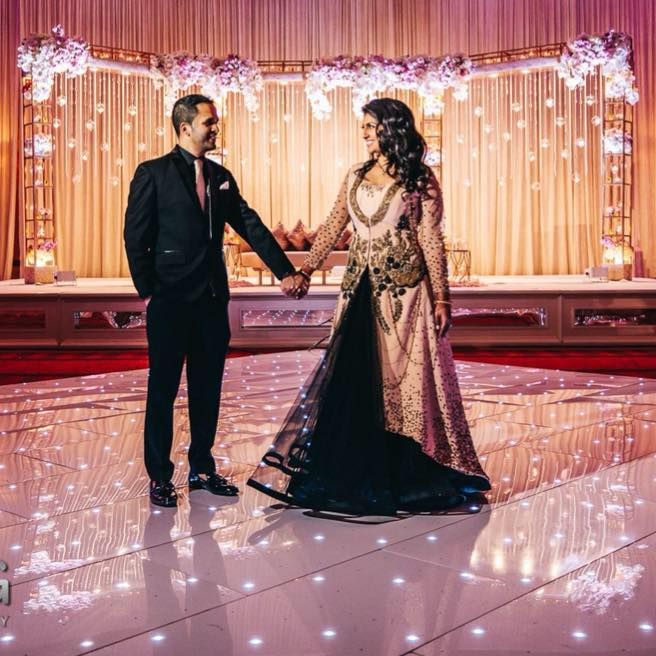 """Renita & Jay Patel - I first saw Utopian Events' work at my cousins wedding in 2013. I still remember when my mom and I walked into that reception we could not stop admiring the work. Fast forward to 2017, when I got engaged I knew UE was one of our first decorators to call! We had an amazing face to face meeting and from then on there was no question on the collaboration! Shushil is great at getting to know his clients and really understanding not only what they want but their personal flares. I can't count the number of my friends who came up to me and said """"this decor FEELS like your wedding. It is so you!"""" Even though we new what the event was supposed to look like, my husband and I would still take a minute before our photo shoot to take in the amazing work the team had done. It exceeded our expectations! From Shushil to Angelica, the whole team really puts their heart and sole into your wedding. I felt more calm seeing them before each event and knowing that they would make sure everything was moving without a glitch. The personal touch that they bring is really above all and friendship and connection made that year will never be forgotten!"""