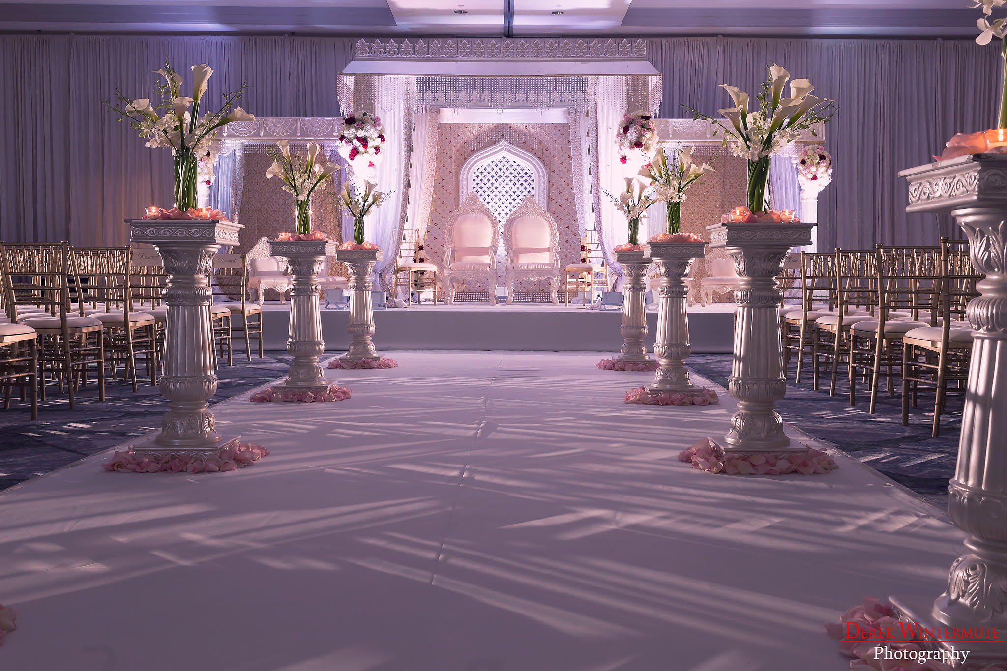 Pooja Lalwani - Beautiful, gorgeous, stunning, amazing… I simply do not have enough adjectives to describe the decorations created by Utopian Events for our wedding! Utopian helped to design multiple events for our wedding and each time I walked into the room before the event, I was literally stunned by the beauty of the room. However, what is truly amazing is that each successive event was even better than the last. Our mehendi was whimsical, elegant, and colorful. The ceremony was cool, sleek, but at the same time so ornate. And finally, our reception literally left me speechless with as it struck the perfect balance between being sparkly, but also so incredibly sophisticated! I don't know how to even thank Shushil, Angelica, and the entire team at Utopian Events – they took my incredibly vague ideas and transformed them into something any bride would LOVE to have at her wedding!If you are considering hiring Utopian Events for your wedding – here are a few details about my experience that may help you along your way. First off, I am a bride that lives in the North East, but decided to have the wedding in Atlanta. As a result, I had to meet with many of my vendors during my few and far between whirlwind weekend trips to Atlanta or work with my vendors remotely. During one of my trips to Atlanta before the wedding, we met with a number of different decorators and I have to say, there is absolutely no competition between what Shushil offers and other decorators in Atlanta (I know that sounds so mean to the other decorators, but I truly believe Shushil stands well above everyone else! :P).Here is why I think UE was so amazing though: 1. The inventory available with UE was much more extensive than many others; 2. The creativity displayed by Shushil during our first meeting – I gave him some ideas as to what I wanted and he immediately began tossing out ideas and showing me a variety of pictures to hone in on my tastes.; 3. The high level of responsiveness – there was n