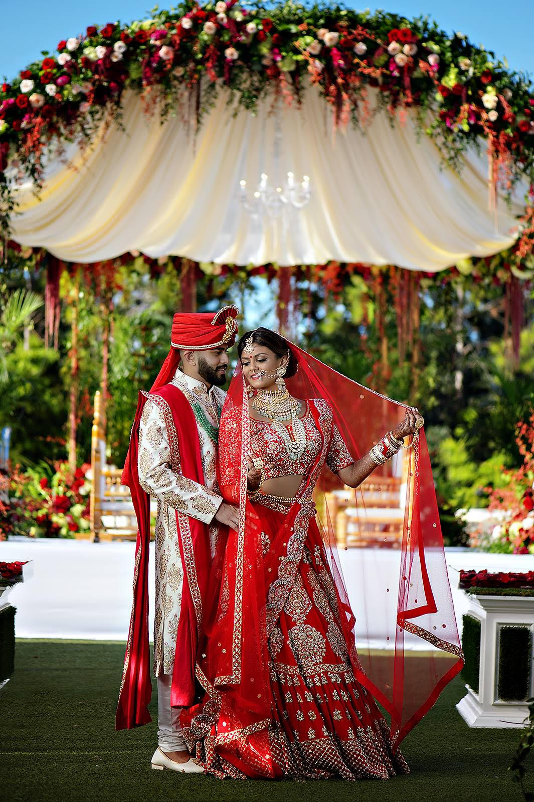 Manali & Nikesh Patel - Utopian Events was at the top of my list when choosing a decorator for my wedding. After speaking with Kinjal Patel, Event and Sales Manager, for the first time I was committed to having Utopian bring my wedding to life.Decor is such a crucial part of a wedding, the Utopian team truly knows how to bring a bride's vision to life. They also have so many wonderful recommendations to turn a simple idea into the highlight of your event. Kinjal was very generous, open-minded, and full of ideas she knew would make my wedding complete. She took the time to talk to me for about 30 minutes when we were first introduced just to get to know me so she could better understand my vision. I had never received such courtesy from a vendor before. We clicked right away and she began to show me photos of decor she thought would match my vision. We talked multiple times in person and over the phone to finalize every detail of the wedding events. Kinjal was so easy to talk, and so easy to get a hold of. Other vendors I would have to call over and over, but with Utopian, I never had that problem.My major focus for decor was my Mandap. I wanted it to be something spectacular, like out of a movie. Florals, water features, greenery, candles, chandeliers, the works! Kinjal knew how much my mandap meant to me, so she presented me with multiple sketches and photos for inspiration (which she did for all my events). Finally, when the day came to see my mandap, I was blown away. I had to catch my breath before I could take in the glorious beauty of my dream mandap. It was just how I imagined it in my head, and it was brought to life by the Utopian Events team. I loved it so much, it became the major backdrop for my wedding photos. I wanted the beauty of that magnificent creation to shine in my photos.Aside from creating my dream mandap, Kinjal and the Utopian Events team truly went above and beyond my expectations to create my dream wedding. All my pre-wedding events were d