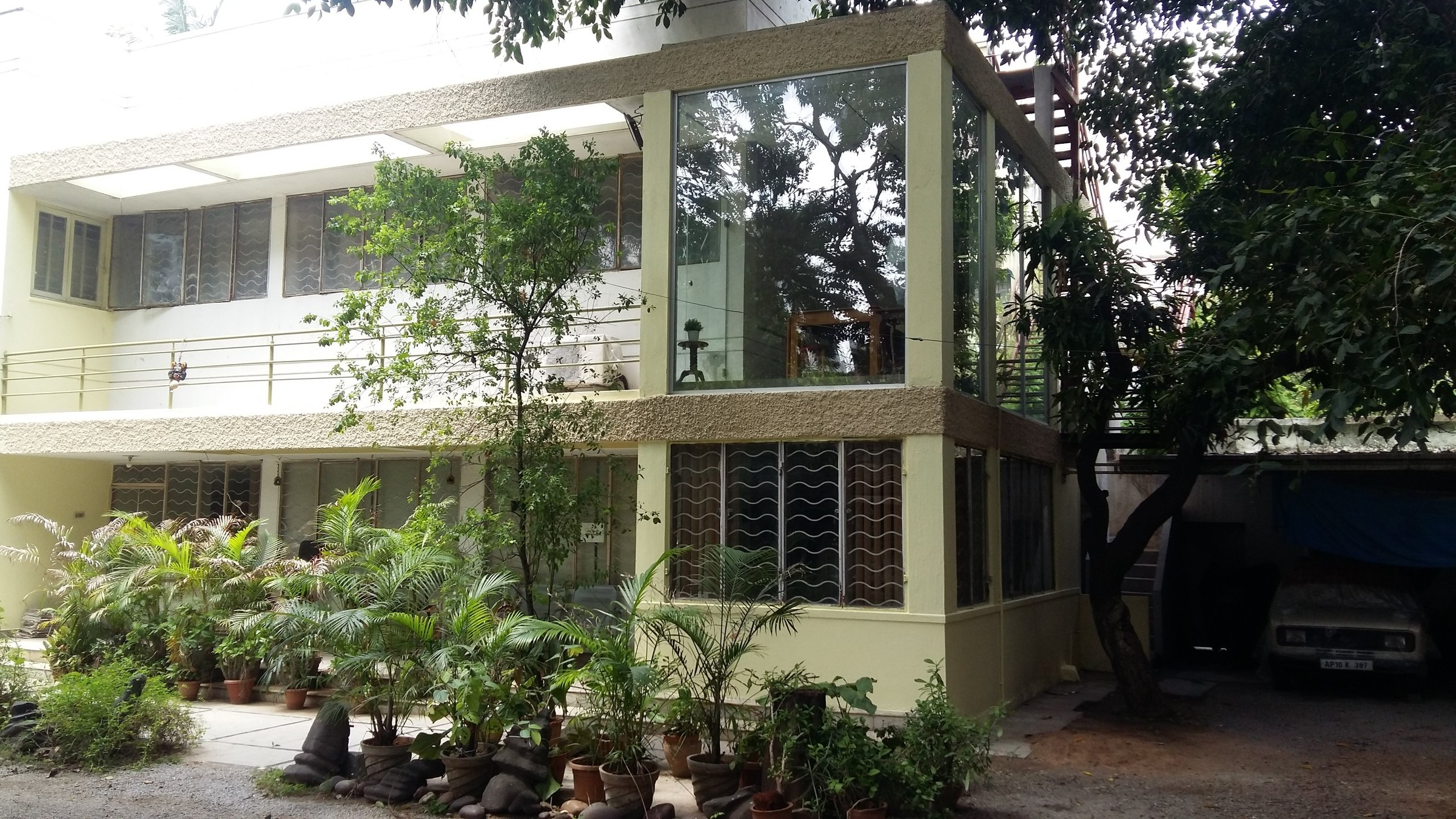 """The office at Magal Associates was established in the 1930's, although the firm itself was established in 1925. The office building is endowed with an excellent natural habitat, including Coconut, Mango and other fruits bearing trees in the Orchard On-site. The premise is affectionately called the """"Best Farm-House"""" in the center of Hyderabad city by some of our clients. The habitat here attracts various migratory birds (such as Eurasian Oriole) from as far as Eurasian regions. This is one of the few places for an office where one can tell time of the day by the type of bird song. Early morning one can hear the Cuckoos, Parrots and the Bulbuls. At the noon one can hear Mynas and the Eurasian Oriole. Past 5 p.m one may hear a variety of Fly catchers and other small birds ethnic to the region returning to their homes. An occasional visitor is the endangered Indian Pittah.    The philosophy of design here rests on """"Excellence by design"""", based on integrity, value - engineering and safety.    Architecture here is the responsibility of designing the built environment taking into consideration the Health, Safety and well being of the end users. The design must have a sense of style that transcends style and hopefully not out of place even in different cultural contexts. Ultimately the culture of the society may be judged by the architecture it produces and it shows how well the architects within it design the built environment. The building itself has been a Green building since 1930's. The entire office interior does not need artificial lighting during the day and more than 50% of storm water run-off from the site and the building rooftop is harvested for gardening. Also a significant amount of plant and tree waste is used as compost to sustain the trees and plants on site. Last but certainly not the least the people at Magal Associates are carefully associated with the firm from the best Institutes of India and get trained to work on projects of National and Internationa"""