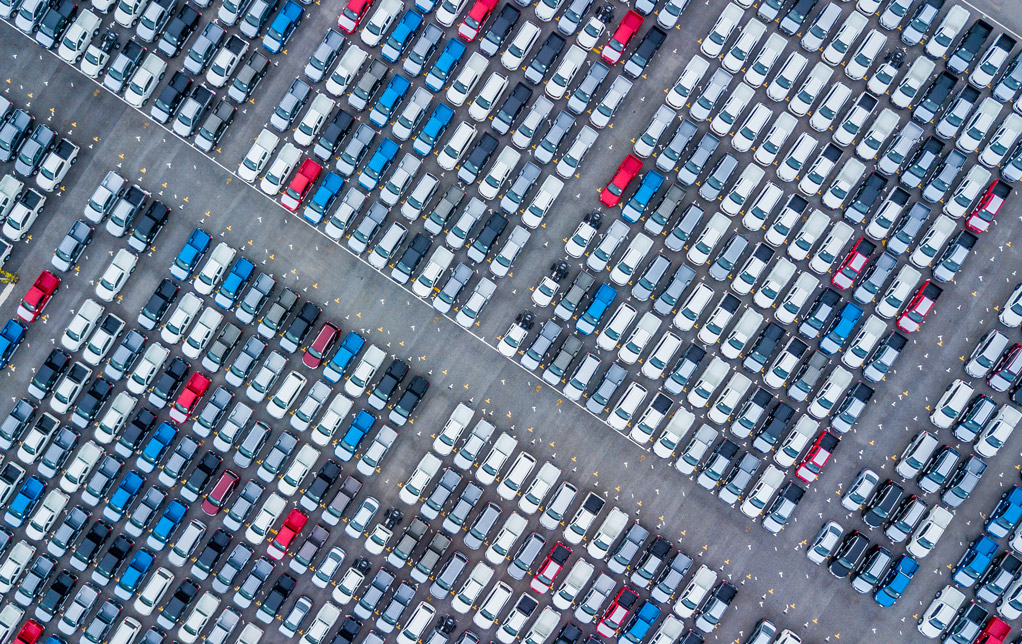 Aerial view new cars lined up in the port@0,3x.jpg