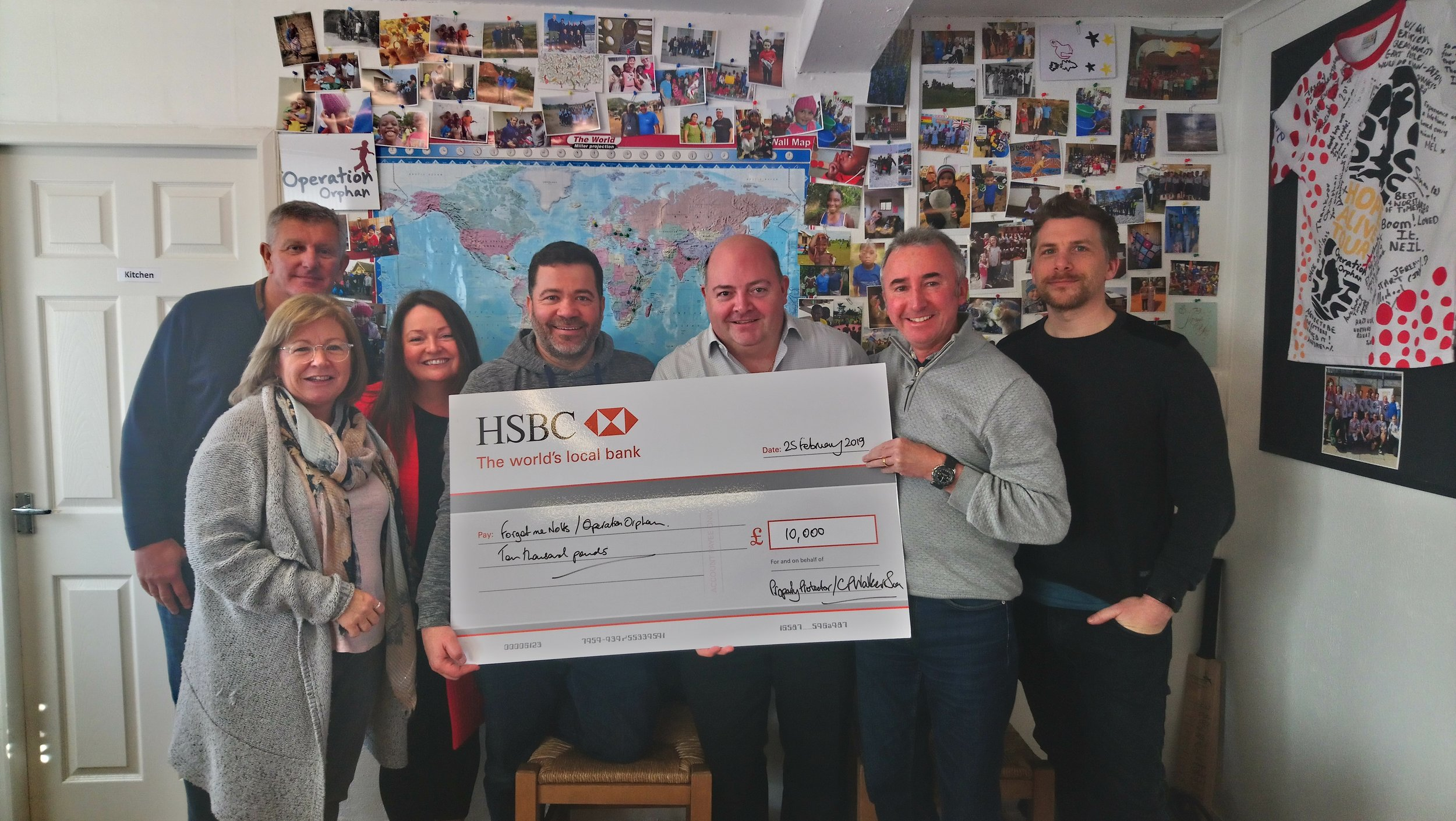 Here are our trustees receiving the surprise cheque!