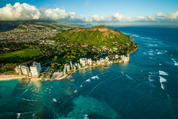 Diamond Head - The perfect location with the perks of the verdant mountain range to the Northeast and the turquoise ocean water to the South.