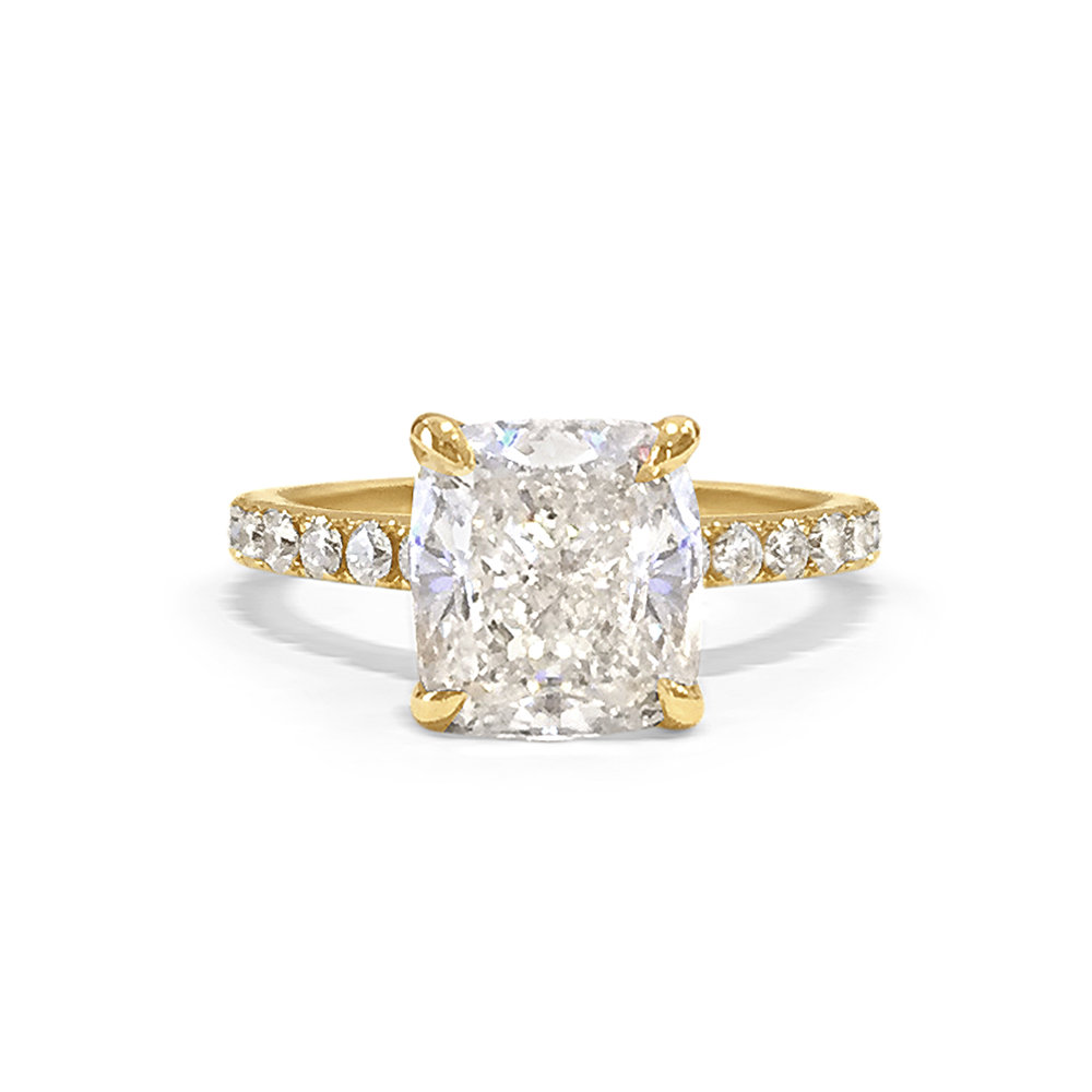 A+showstopping+2.63ct+cushion+cut+talon+claw+set+diamond+on+a+micro+set+round+brilliant+diamond+band+in+18+carat+yellow+gold+with+hand+engraving+2.jpg
