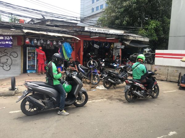 Go-Jek workers riding their unicorns through the streets of Jakarta.