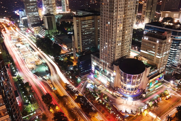 The energy and light of Jakarta by night (Photo by  Gede Suhendra  on  Unsplash )