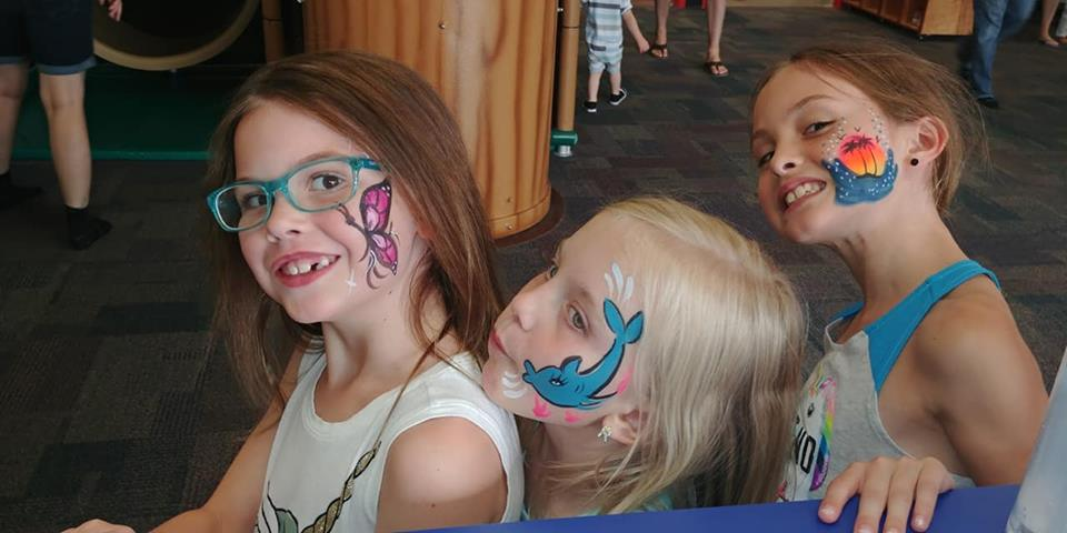 Three girls with face paint