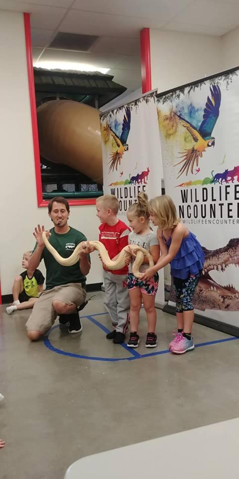 Kids holding snake