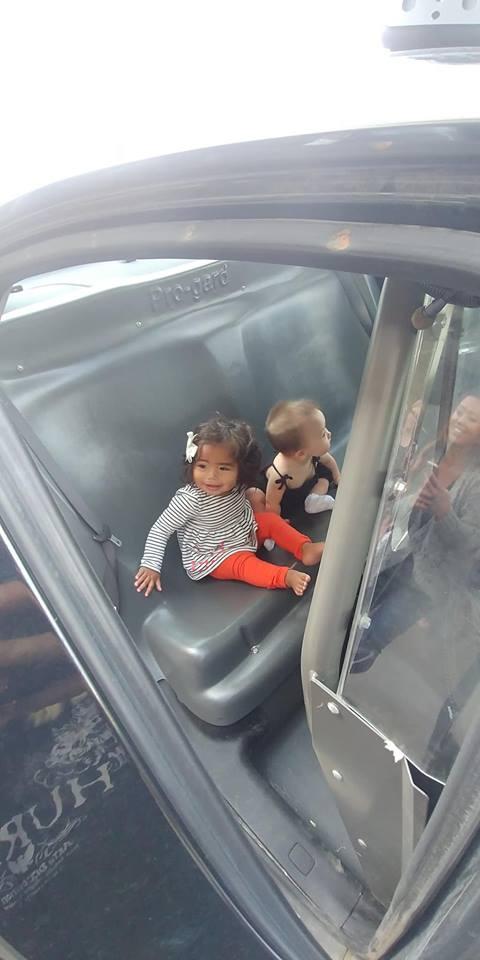 Kids in police car