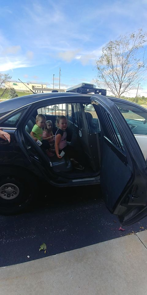 Children in police car