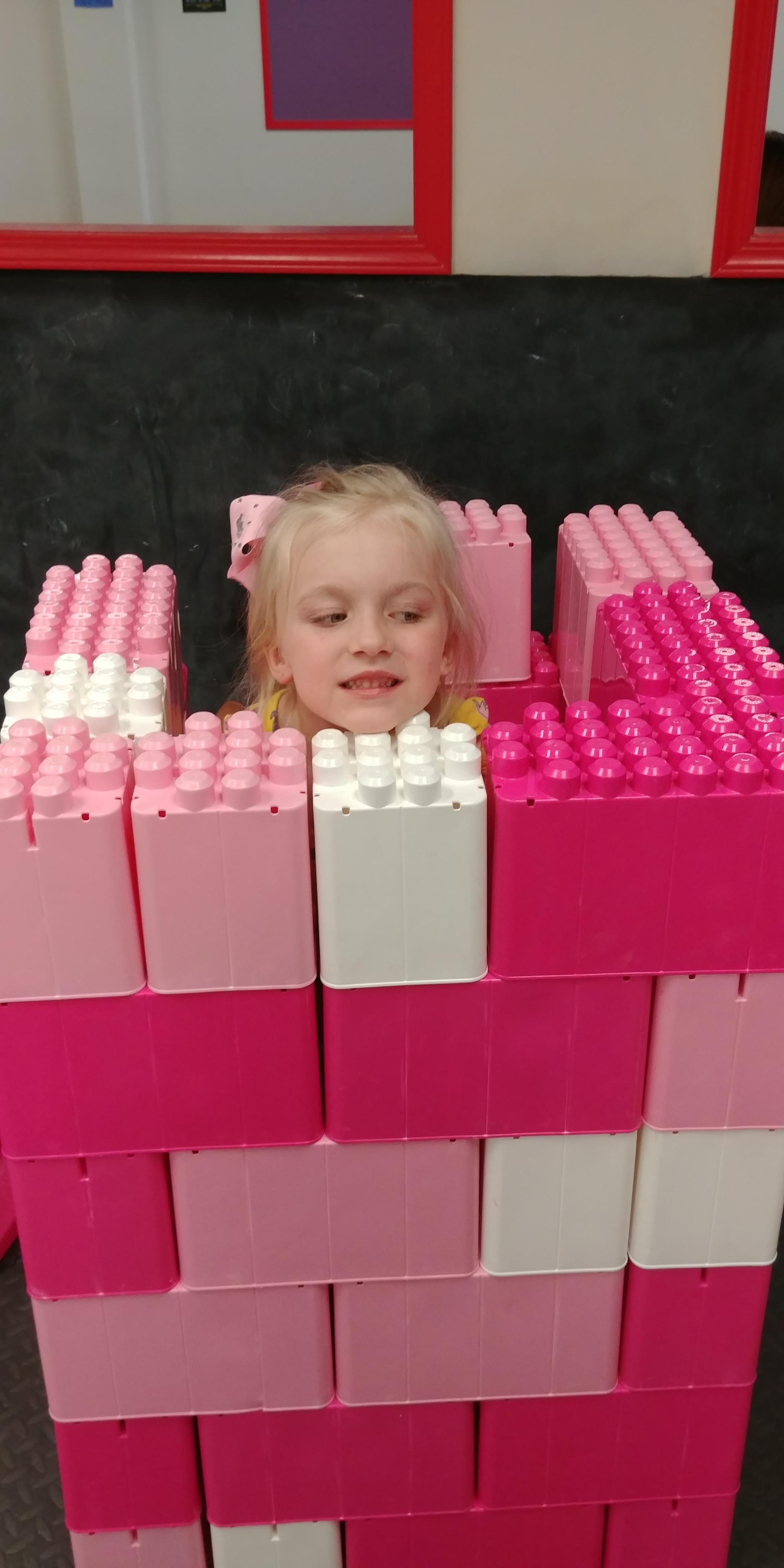 Girl in block tower