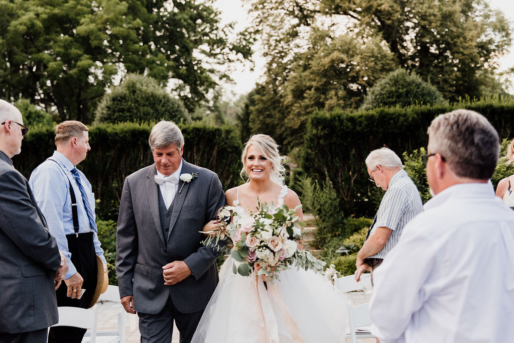 Walking to her forever… - It was hard deciding where to look when the bride came down the aisle. Emily's beautiful entrance or the look on Jeff's face when he sees her?