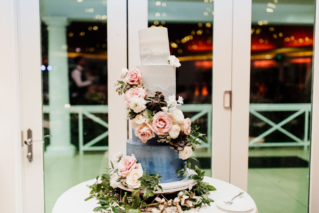 Who wants cake? - We are obsessed with this four-tiered tie-dye cake with floral accents!!