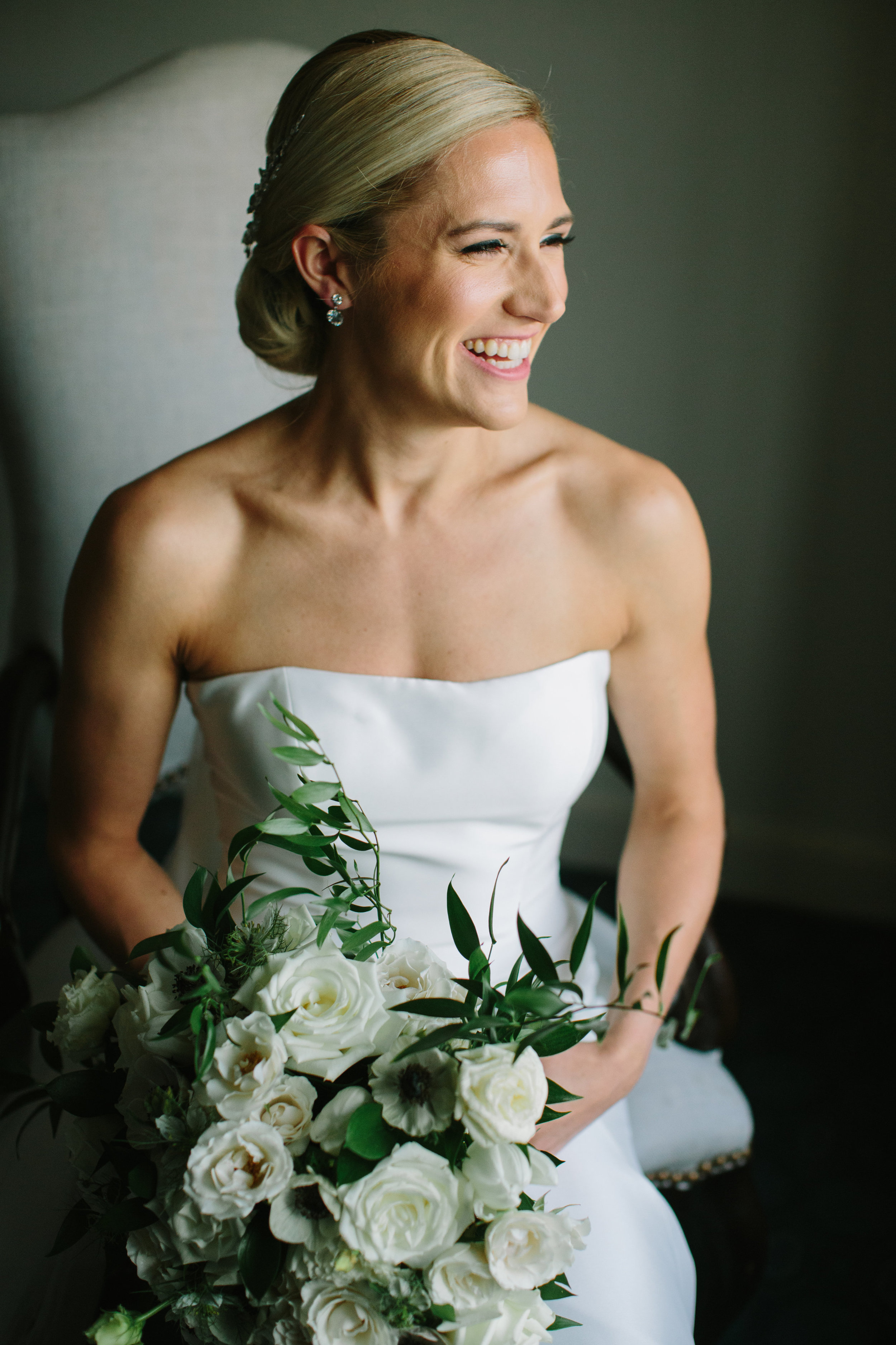 """Gourgous Bride - Erica's smile is completely infectious as she """"posy's"""" for pictures on her big day! No wedding jitters here!!"""