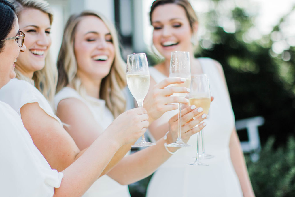 Cheers! - There is something so special about having your best friends by your side on your big day! We loved that Rachel decided to go with an all-white scheme for her bridesmaids. The effect is so clean and lovely.