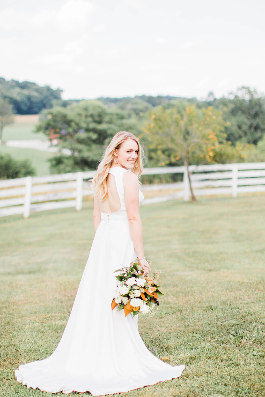 The bride was radiant… - Rachel was truly stunning on her big day! In her bouquet you can see we also included another fun element: wild Virginia blackberries! We loved combining the hops and blackberries with fragrant magnolias and delicate gardenias to create this very special bouquet!