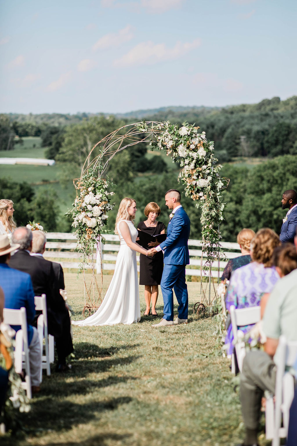 """They said """"I do"""" - Rachel & Patrick exchanged vows under this rustic arch, that looked heavenly draped in the mix of hops, magnolias, gardenias and greenery!"""