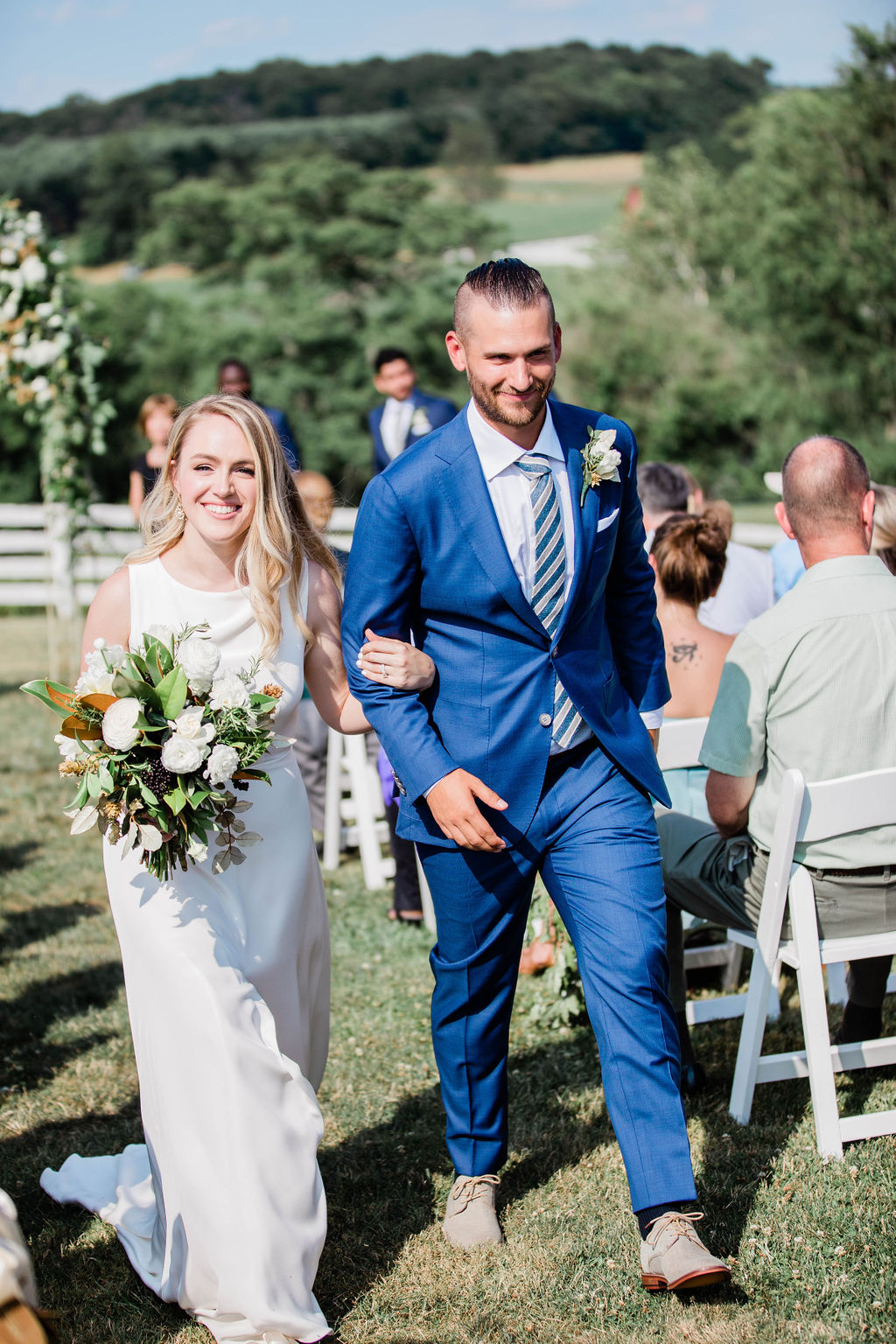 It's official! - Rachel & Patrick's beaming faces as they walk together as husband and wife for the first time is perfection!