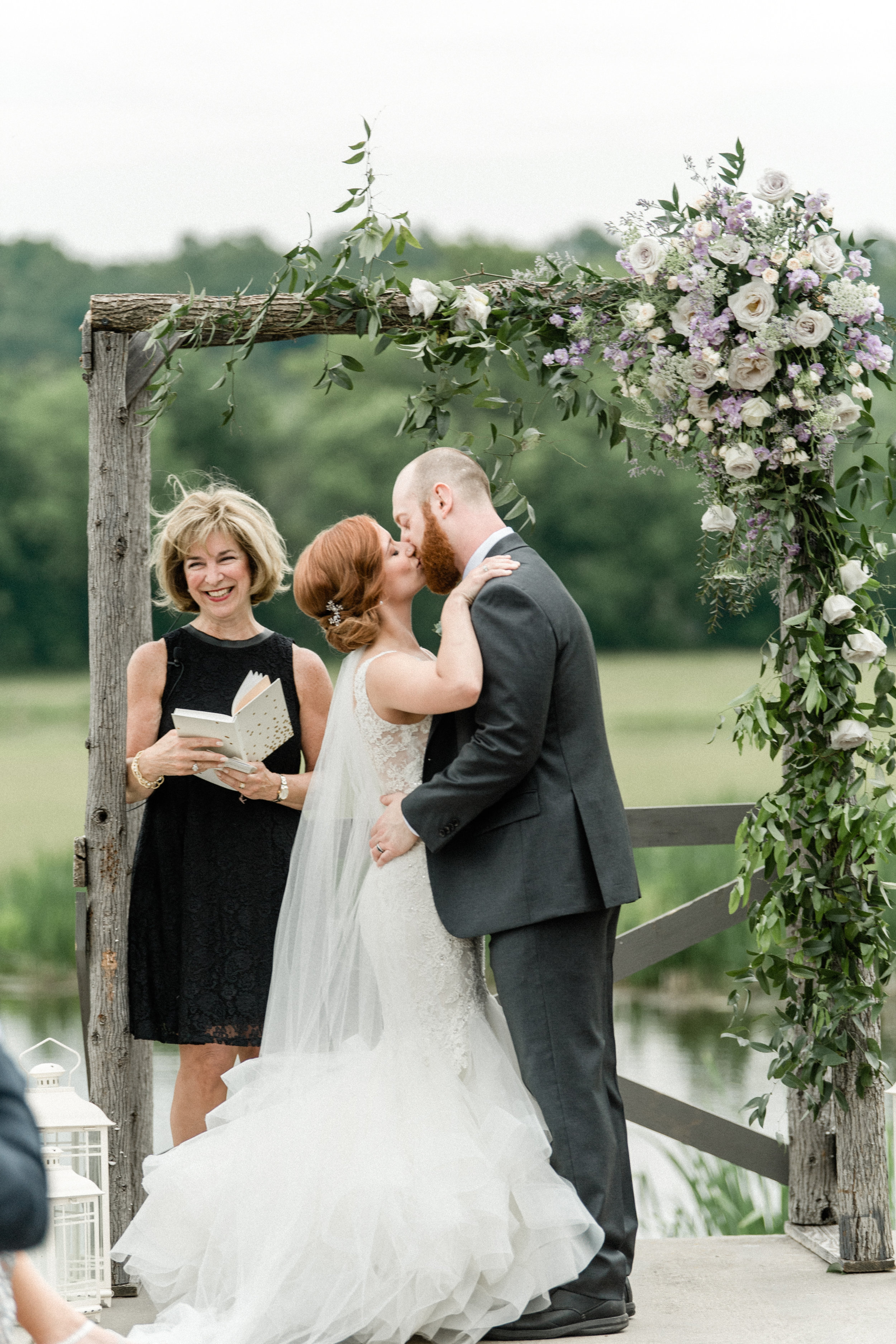 """Mr. & Mrs. - Jackie & Bryce said """"I do"""" under this unique arch! The wood elements mixed with the asymmetrically placed flowers turned out stunning!"""